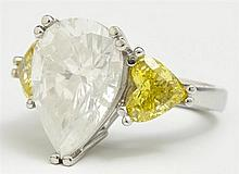 Lady's Platinum Dinner Ring, with a 9.02 carat pear shaped diamond, flanked by two yellow diamond hearts, total yellow diamond wt.-...