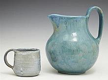 Two Pieces of Shearwater Pottery, consisting of a large mouthed pitcher and a blue coffee cup with ribbed decoration, Pitcher- H.- 7...