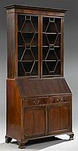 English Edwardian Style Carved Mahogany Secretary Bookcase, late 19th c., the stepped crown over double astragal doors, on a base wi...