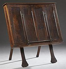 American Aesthetic Carved Walnut Folio Cabinet, c. 1880, the stepped lifting lid over a slant front with inset panels and incised de...