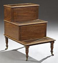 English Carved Mahogany Bed Steps with Commode, c. 1900, the three steps with inset gilt tooled leather tops, the lifting top lid wi...