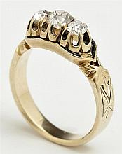 Lady's 18K Yellow Gold and Enamel Diamond Ring, c. 1900, with a central 25 point round diamond, flanked by two 15 point round diamon..