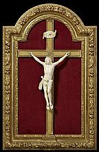 Carved Ivory Crucifix, early 20th c., on a gilt wood cross, presented in an arched gilt and gesso shadowbox frame, verso with a dedi...