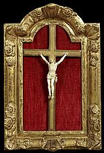 Carved Ivory Crucifix, 19th c., presented in a gilt and gesso shadowbox frame with floral relief decoration, Frame- H.- 21 in, W.- 1...