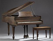 Carved Mahogany Baby Grand Piano, c. 1940, together with a matching piano bench, H.- 39 in., W.- 55 in., D.- 55 in.