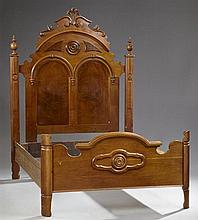 Victorian Carved Walnut Bed, late 19th c., the scrolled crown over a double arch headboard flanked by urn form finials, the serpenti...