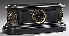 Bronze and Black Marble Mantel Clock, 19th c., by Tiffany and Co., time and strike, the oval stepped case with a central black marbl...