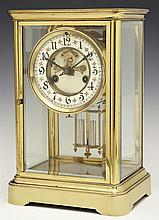 Waterbury Brass Open Escapement Anniversary Clock, c. 1900, time and strike, with an enamel chapter ring, and a faux mercury pendulu...