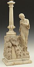 Carved Alabaster Figural Table Lamp, early 20th c., depicting a woman leaning on a rocky wall, issuing a tapered column, on a highly...