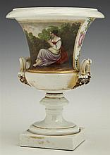 Old Paris Porcelain Campana Form Urn, mid 19th c., with gilt and floral decoration and a central reserve of a female flautist, flank...
