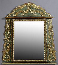 Venetian Style Parcel Gilt Polychrome Cushion Mirror, 20th c., the arched flower and foliate crown to a stepped edge over a serpenti...