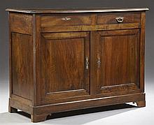 French Provincial Carved Mahogany Louis Philippe Sideboard, 19th c., the canted corner stepped edge top over two frieze drawers, abo...