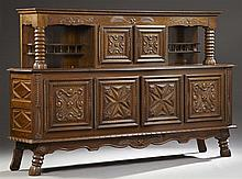 French Provincial Brittany Style Parquetry Inlaid Oak Court Cupboard, c. 1900, the stepped top over a fleur-de-lis and wheat carved...