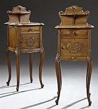 Pair of French Louis XV Style Carved Walnut Marble Top Nightstands, early 20th c., the floral decorated shield form back with a cand...