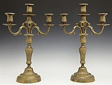 Pair of Louis XVI Style Gilt Bronze Four Light Candelabra, 20th c., with relief decorated candle cups on three relief decorated scro...