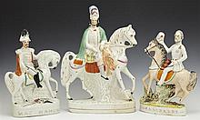 Group of Three Polychromed Staffordshire Figures on Horseback, consisting of