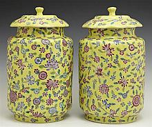 Pair of Large Chinese Covered Jars, 20th c., with swirled and floral decoration, on a pale yellow ground, H.- 11 1/4 in., Dia.- 6 1/...