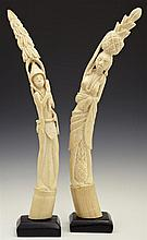 Pair of African Carved Ivory Tusks, 20th c., of a man and a woman, on ebonized wooden bases, Tusk- H.- 19 in., W.- 2 3/8 in., D.- 1...