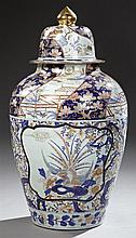 Large Imari Style Covered Porcelain Baluster Palace Urn, 20th c., with landscape and floral decoration in cobalt, gilt, orange, and...