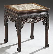 Chinese Export Carved Mahogany Marble Top Taboret, 20th c., the inset highly figured rouge and ochre marble, on foliate carved legs...