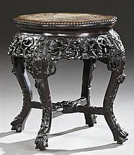 Chinese Export Highly Carved Marble Top Taboret, early 20th c., the inset floriform rouge and ochre marble top within a scalloped be...