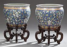 Pair of Oriental Porcelain Baluster Form Goldfish Bowls, 20th c., with polychromed relief figural, floral, and butterfly decoration,...