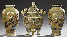 Three Pieces of Satsuma Pottery, late 19th c., consisting of a pair of baluster vases and a large incense burner, all with gilt and...