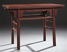 Chinese Provincial Red Painted Elm Altar Table, 19th c., the rectangular top with a serpentine skirt, on circular legs, joined by a...