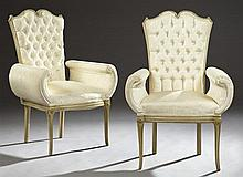 Pair of Hollywood Regency Polychromed Tufted Armchairs, c. 1930, with carved acanthine double arched crest rails over a tapered tuft...