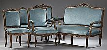 Five Piece French Louis XV Style Carved Mahogany Parlor Suite, c. 1900, consisting of a settee, two armchairs, and two side chairs w...