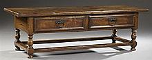 French Provincial Louis XIII Style Carved Oak Farm House Table, 19th c., the single plank top over two frieze drawers, flanked by a...
