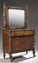 American Classical Revival Carved Mahogany Dresser, late 19th c., the rectangular mirror with applied decoration flanked by carved t...