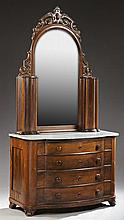 American Classical Carved Rosewood Bow Front Marble Top Wig Dresser, 19th c., the pierced scrolled crest over an arched mirror flank...