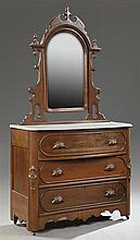 American Victorian Carved Mahogany Marble Top Bowfront Dresser, late 19th c., the arched mirror within a serpentine pierced frame, o...