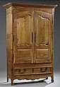 French Provincial Carved Cherry Armoire, c. 1800, the ogee crest over double fielded panel doors with steel fiche hinges and escutch...