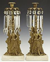 Pair of Brass Girandole Single Candlesticks, 19th c., each depicting a woman in a hat, prism hung, on white marble bases, H.- 15 in....