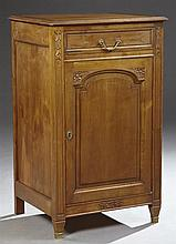 French Louis XVI Style Carved Walnut Confiturier, early 20th c., the ogee stepped edge top, over a frieze drawer, above a fielded pa...