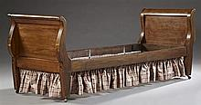 French Empire Revival Carved Mahogany Day Bed, 19th c., the scrolled sleigh ends to tapered block legs, joined by a single plank rai...