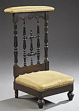 Victorian Ebonized Mahogany Prie Dieu, c. 1900, the upholstered arm rest over a turned cross back splat, flanked by turned supports,...