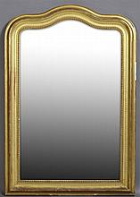 French Gold Leaf and Gesso Overmantel Mirror, early 20th c., the arched back over a stepped beaded frame around an arched plate, H.-...