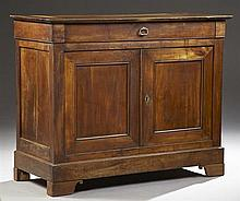 French Louis Philippe Carved Cherry Sideboard, c. 1830, the rectangular top over a single frieze drawer, above double cupboard doors...