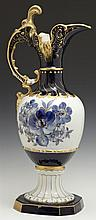 Royal Dux Porcelain Ewer, 20th c., with gilt, cobalt and blue floral decoration, on a sloping socle support to an octagonal base, H....