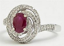 Lady's 14K White Gold Dinner Ring, with a central 1 carat oval ruby, atop a swirled pierced frame mounted with round diamonds, the s..