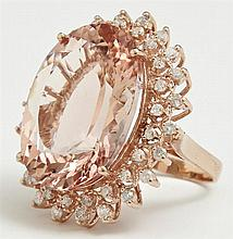 Lady's 14K Rose Gold Dinner Ring, with an oval faceted 26.42 carat morganite, atop a pierced border of round diamonds within an oute..