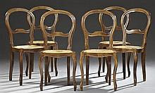 Set of Six Louis Philippe Style Carved Beech Dining Chairs, early 20th c., the open balloon backs over slip rush seats, on cabriole...