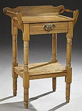 American Carved Cherry Washstand, 19th c., with a serpentine backsplash over a single drawer, flanked by towel rods, on turned legs...