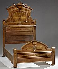 American Eastlake Carved Walnut Double Bed, c. 1890, the arched crest with a central shield form keystone over an inset panel flanke...