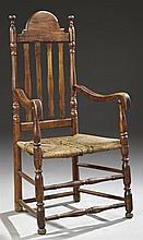 Early American Carved Cherry William and Mary Style Connecticut Armchair, 18th c., the serpentine arched crest rail over a banister...