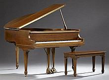 Bradbury Carved Mahogany Baby Grand Piano, New York, c. 1930, with a lift top piano bench, H.- 38 in., W.- 55 in., D.- 55 1/2 in.