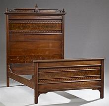 American Eastlake Carved Walnut Bed, c. 1900, the scrolled stepped crown over an applied burl walnut and foliate decorated headboard...